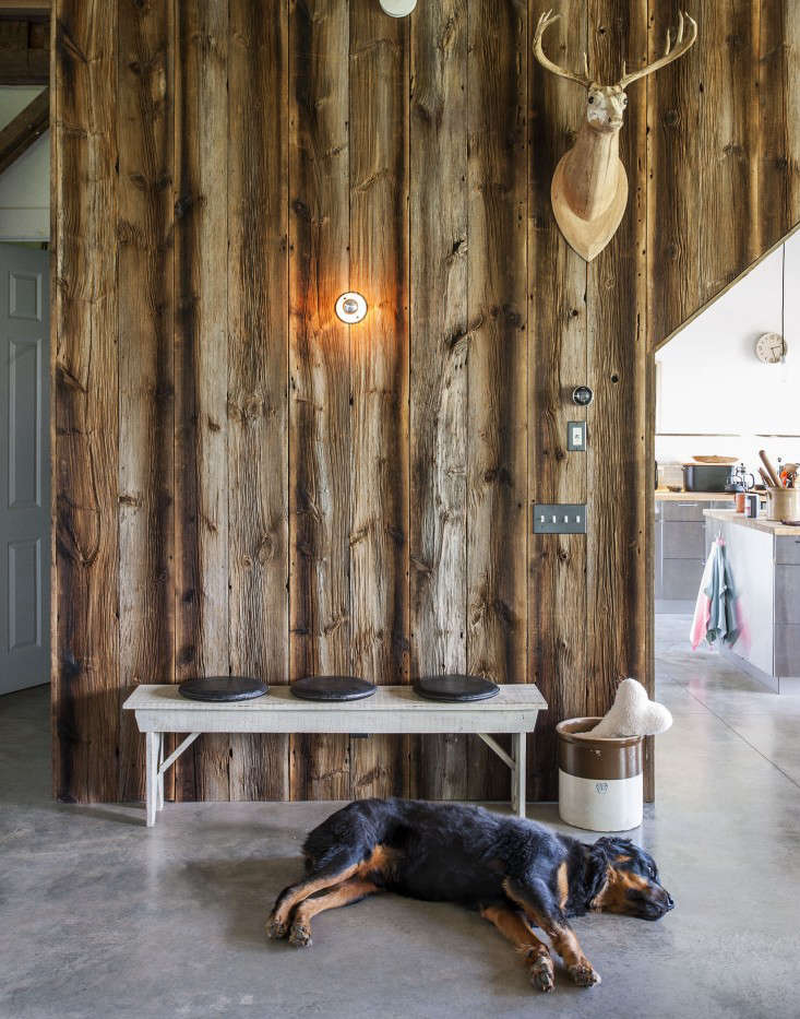 A polished concrete floor with radiant heat works extremely well for a couple who live in a converted upstate New York barn with two giant rottweilers. Photograph by Matthew Williams for Remodelista: Sourcebook for the Considered Home.