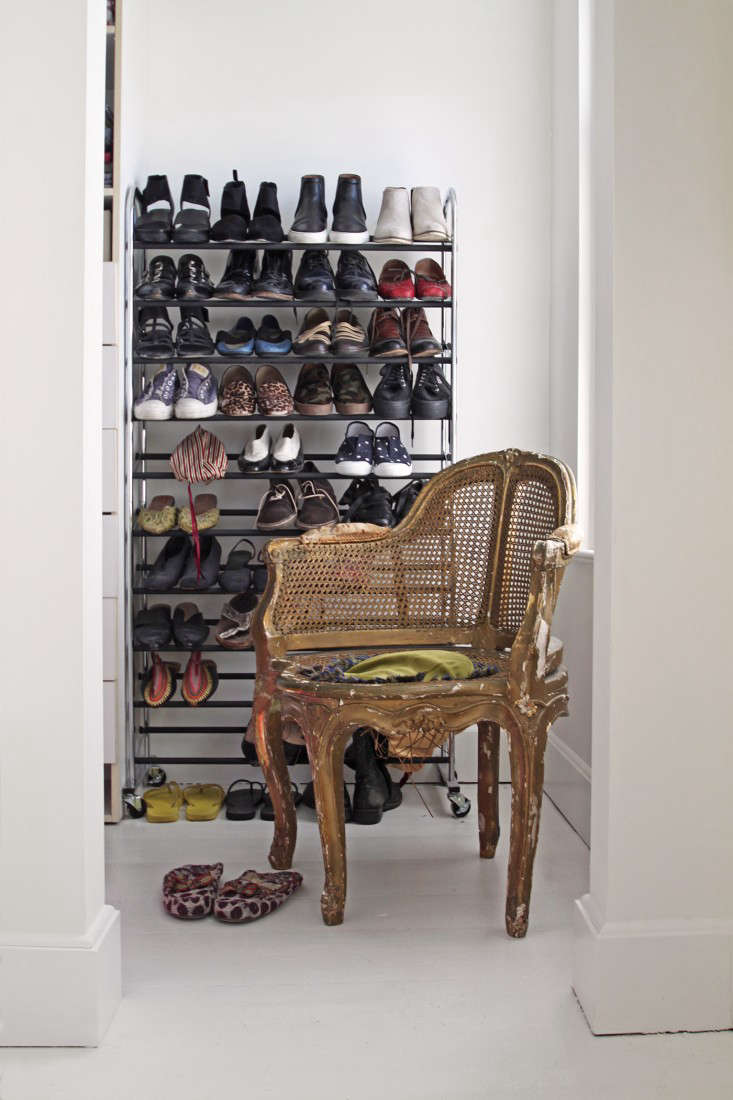 Their hallway closet gets natural light from an interior window, so homeowners Jeffrey and Cheryl Katz opted to remove the door and leave their shoe collection on display. See more in Improper Bostonians: Jeffrey and Cheryl Katz at Home on Beacon Hill. Photograph by Justine Hand.