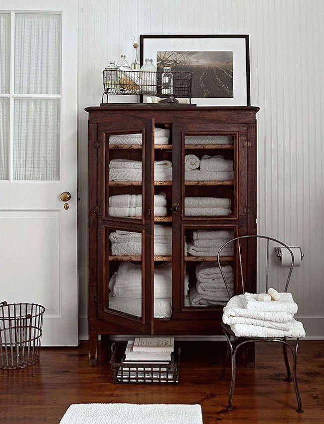 project organized home office armoire. Above: A White Towel-filled Armoire In Bathroom Photographed By Peter Margonelli. Project Organized Home Office