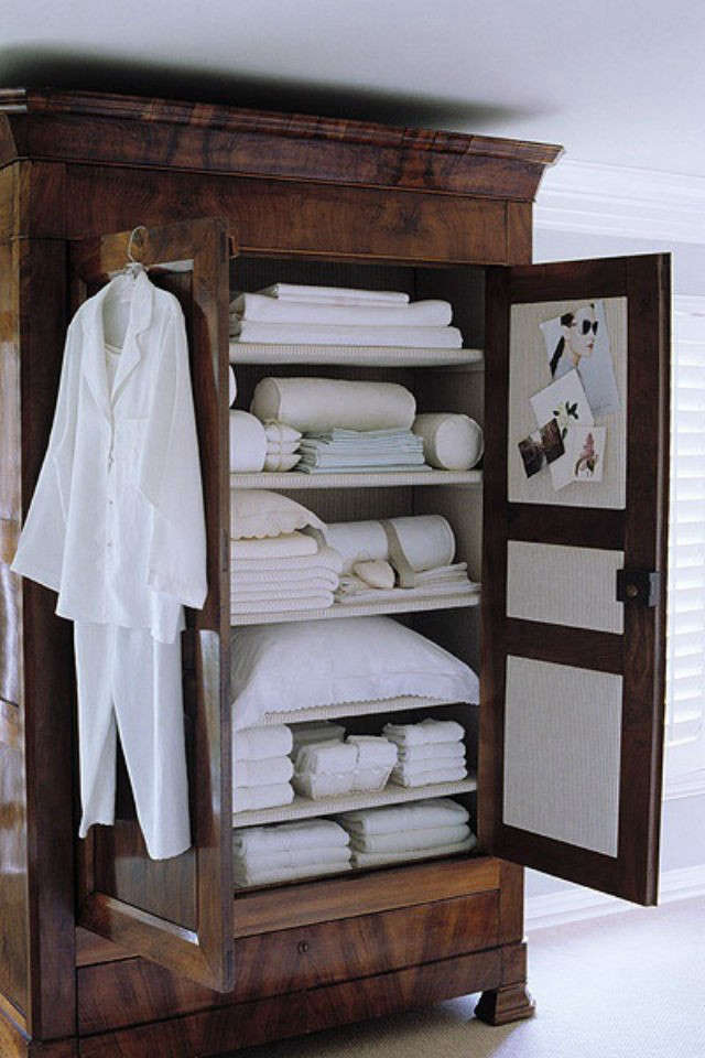 Above: A Dark Wood Armoire With Pure White Contents, Via CharHadas.