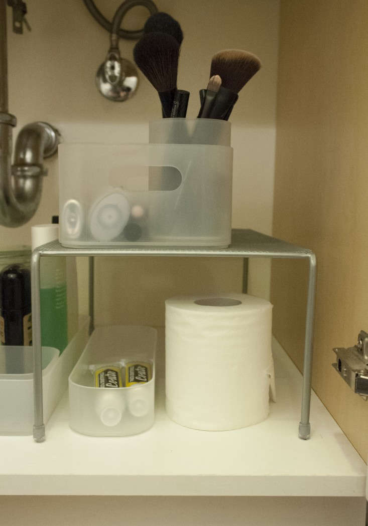 Since I'm a renter, I'm hesitant to install permanent shelving. A good temporary solution is a freestanding design, such as this wire stacking shelf; try the Container Store'sTall Chrome Cupboard Shelf for a similar product; $14.99.