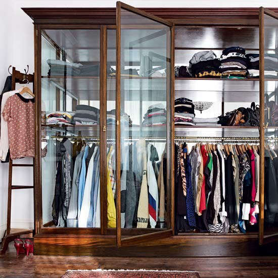 Above: A Vintage Shop Display Cabinet Repurposed As A Glass Storage Wardrobe.  Photograph Via House To Home.