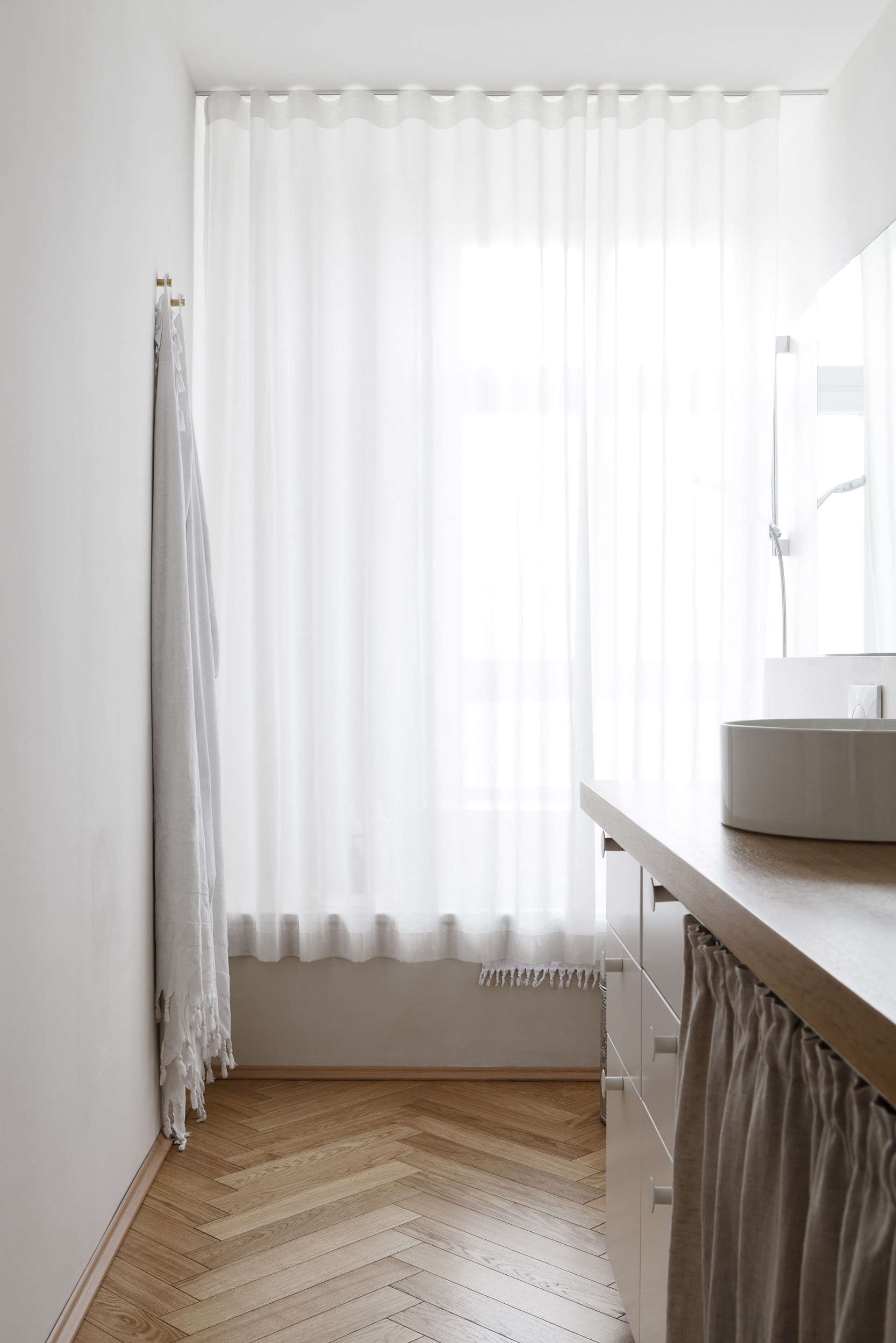 Luxe-minimalist small master bathroom in an apartment remodel by Studio Oink in Mainz, Germany | Remodelista