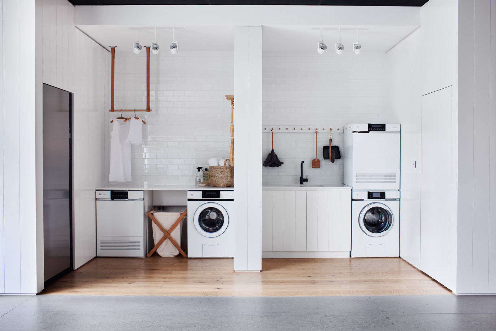 Smart Storage Solutions In An All White Laundry Room In