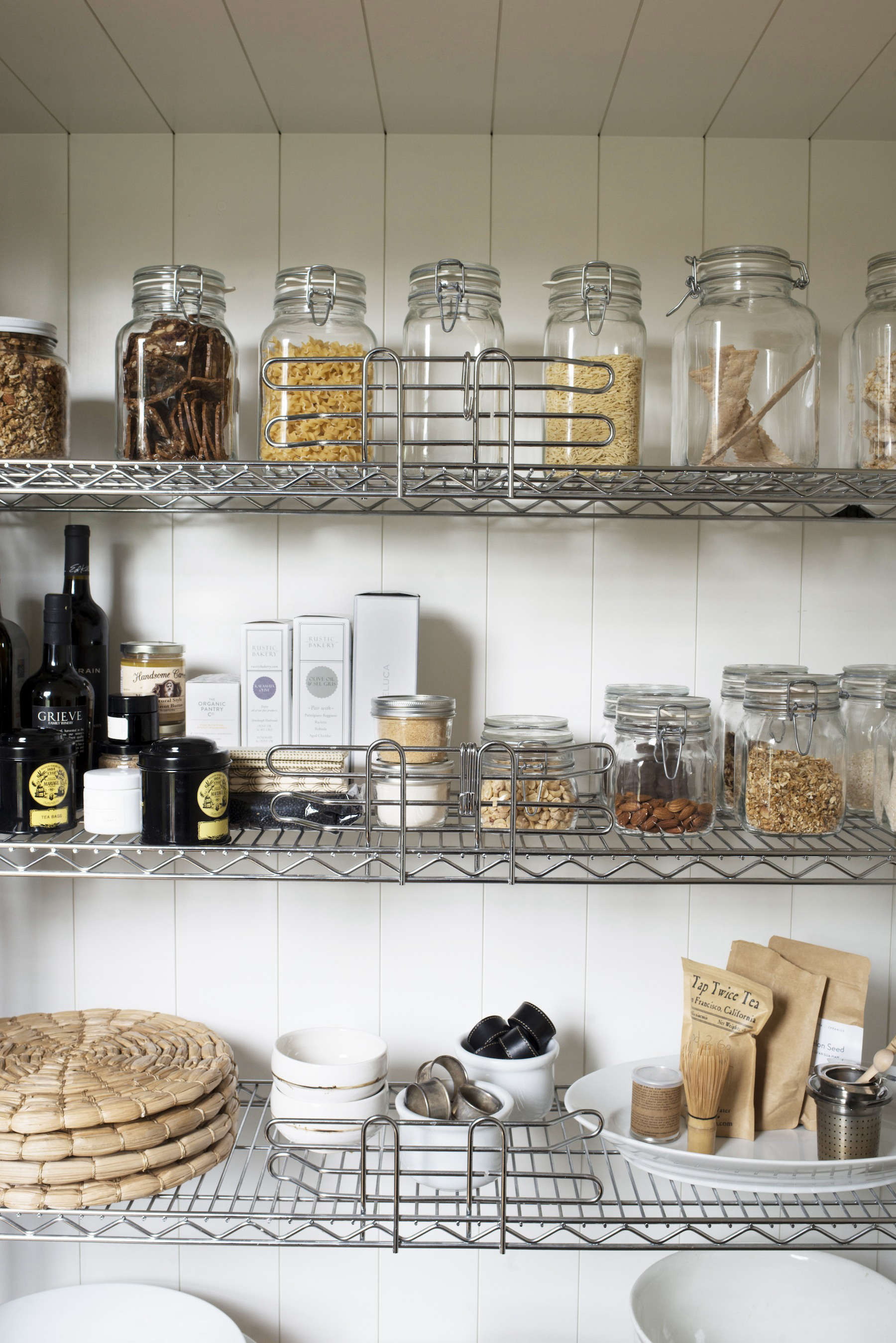 """Says Mill Valley, California, architect Barbara Chambers of her own pantry, """"I realized this could be a fun design if I focused on what it looked like instead of what I was going to stuff in there."""" See more of Barbara's (very tidy) home in House Call: An Exercise in Order with Architect Barbara Chambers. Photograph by Andres Gonzalez for Remodelista."""