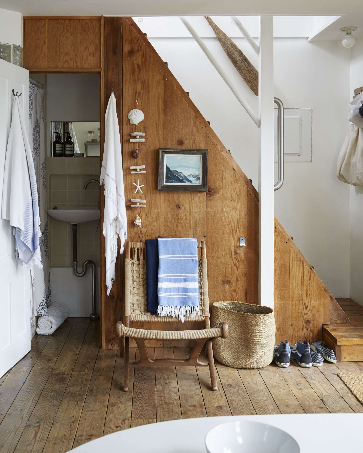 Designer Glenn Ban leaves shoes right by the door in his summer rental. SeeA Beach Cottage in Provincetown, Styled for Budget-Minded Summer Living. Photograph by Stephen Johnson.