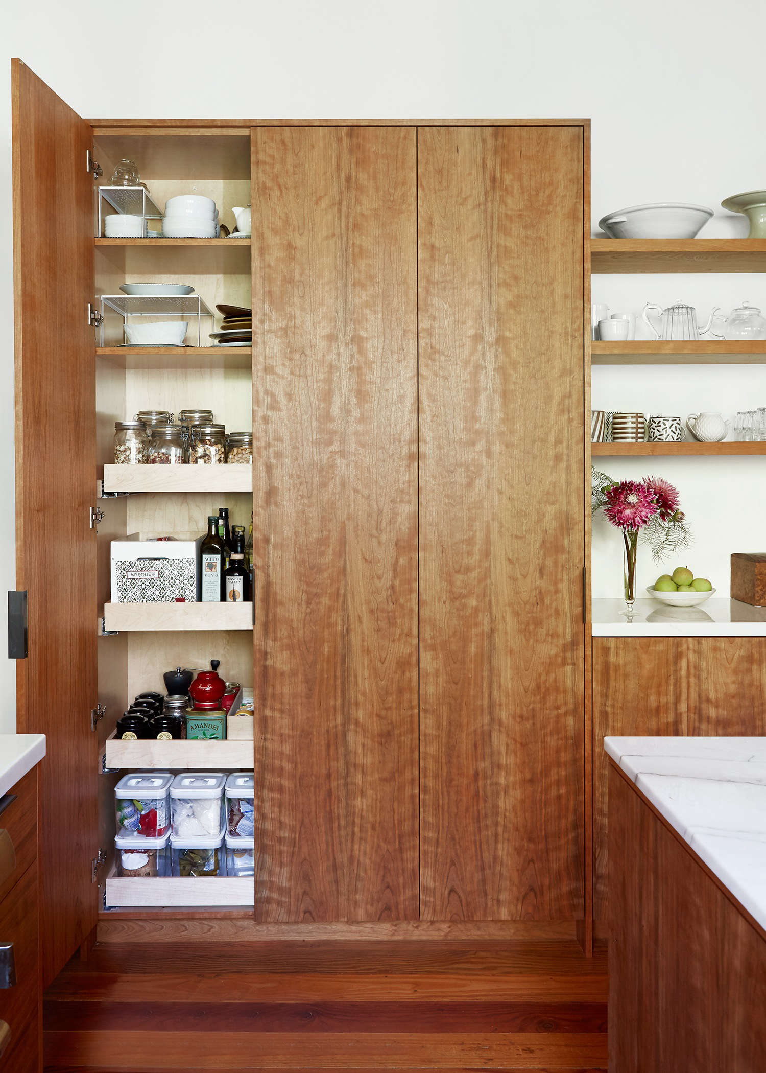 In the previous iteration of photographer Aya Bracket's Oakland kitchen, deep, narrow shelves made it impossible for her to grab the right item. Her new pantry has broad, shallow shelves on rollers. See more in Kitchen of the Week: Aya Brackett's Hippie House Update in Oakland.Photograph by and courtesy of Aya Brackett.