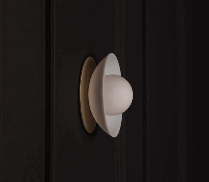 The entryway is subtly lit with a Mini Dome light from Allied Maker, designed by Parsons grad Ryden Rizzo and made in New York. It&#8