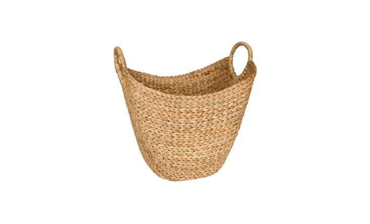 A Woven Seagrass Basket with Handles stores hammam-style striped beach towels in the entryway of this home (the beach is only a short walk away). In your entryway, it might corral shoes, newspapers, or kids&#8