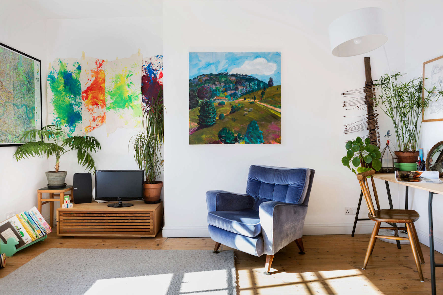 Kids artwork, blue chair, oil painting in remodeled small London apartment