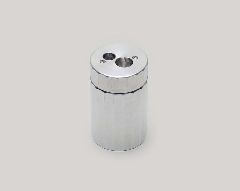 Dux aluminum pencil sharpener.