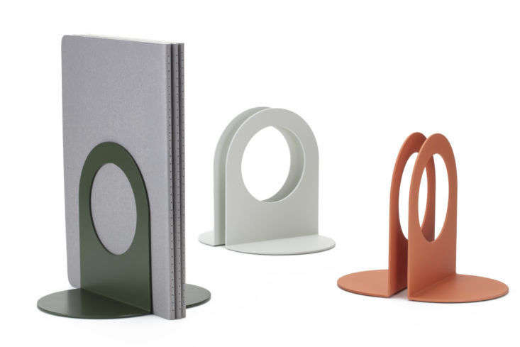 "Most Modest, an SF studio specializing in ""craft-inspired"" tech supplies, makes its Perry bookends from powder-coated bent steel. They come in five colors; $35 per pair."