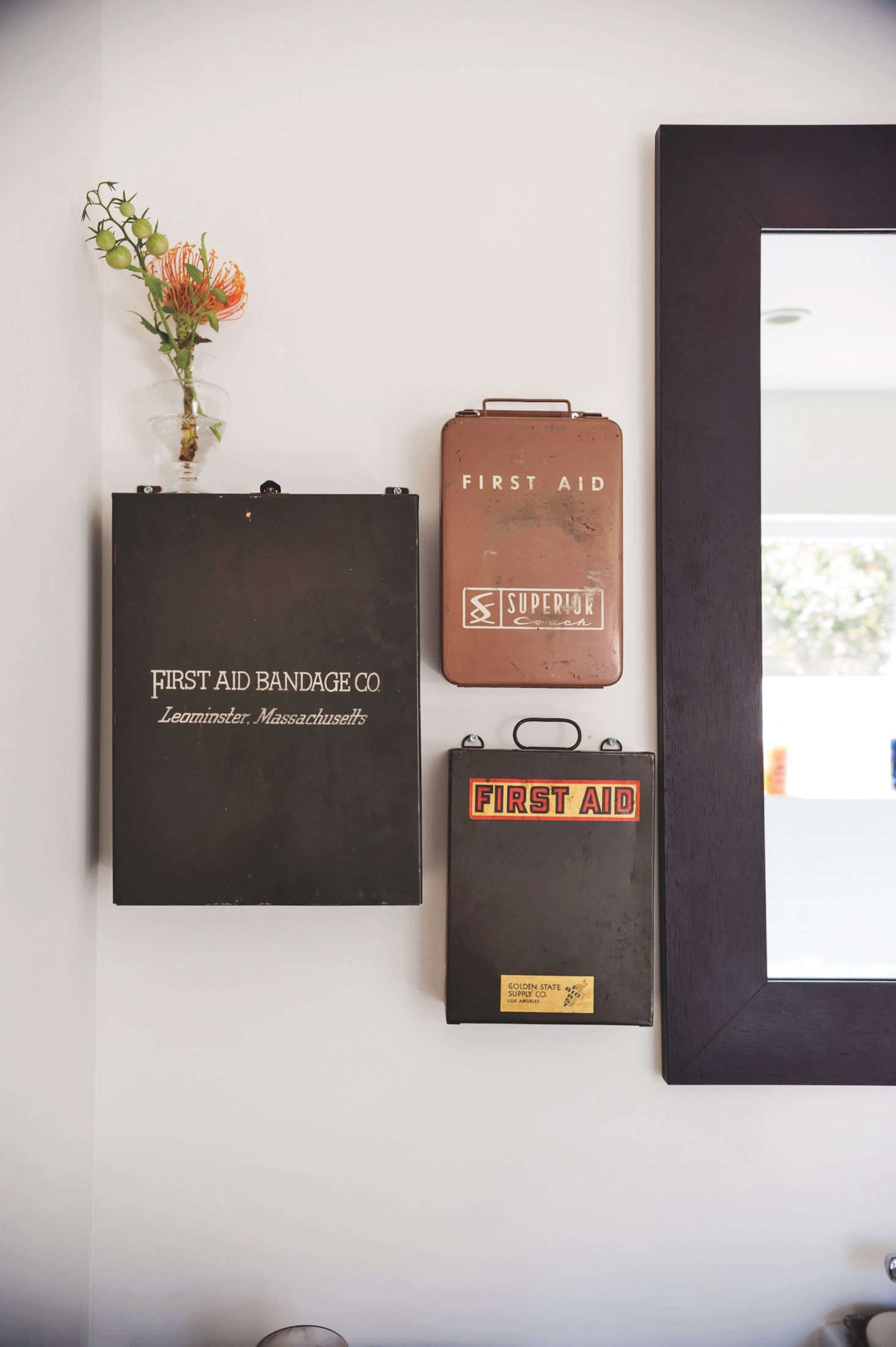 wall mounted vintage first aid boxes as improvised medicine cabinet