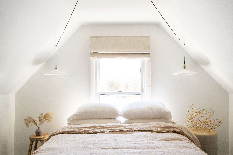 Bed in Lisa Przystup's Remodeled Catskills Attic, Photo by Sarah Elliott