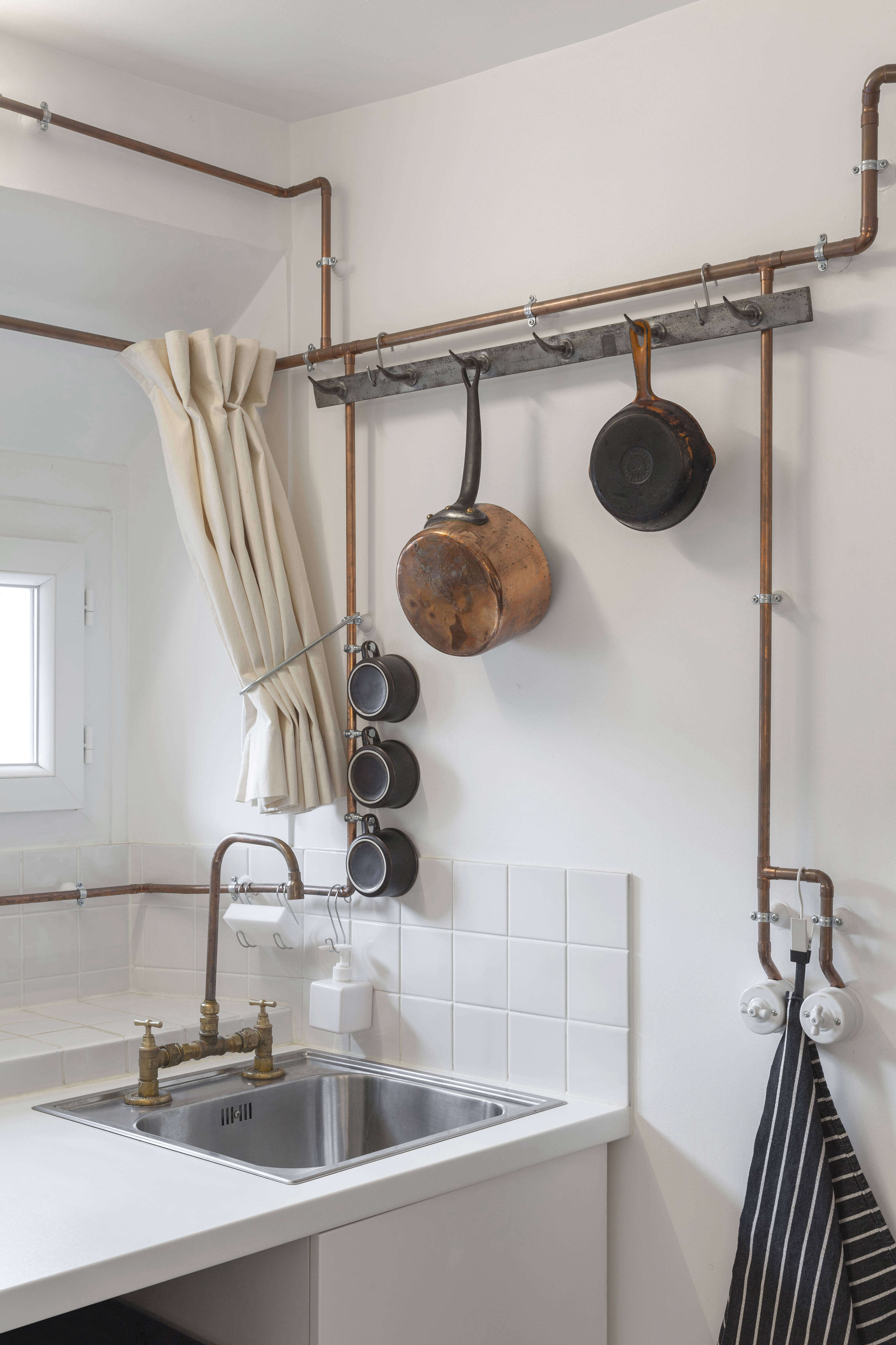 A Tiny Shaker Inspired Studio In Paris Smart Copper Pipe Storage Included