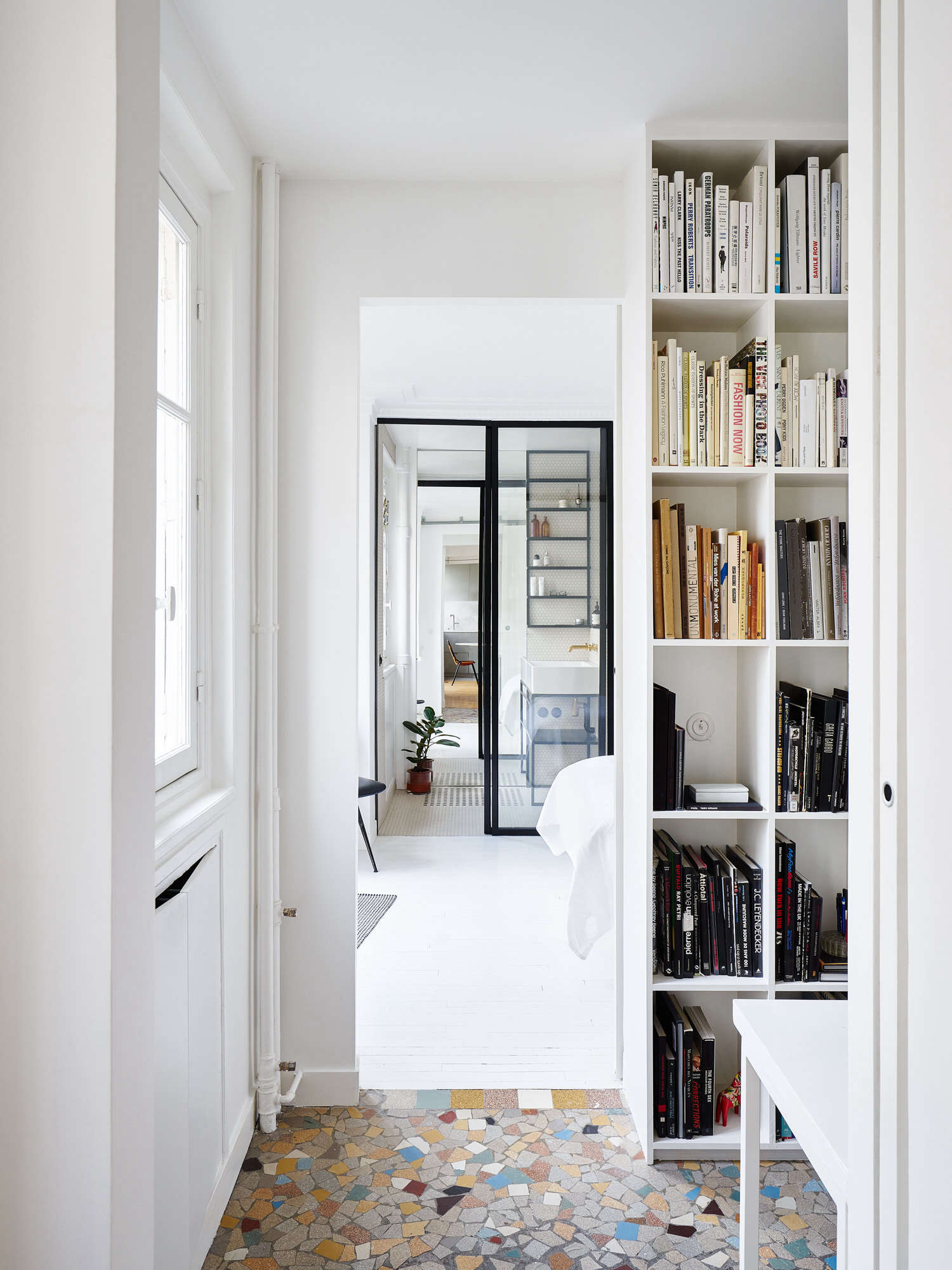 When Septembre Architecture took on a 645-square-foot flat in Paris's 11th arrondissement, the space had too many walls that just made it feel smaller. They deftly reorganized the space and improved the flow, removing walls along the way. See more in Think Big: 9 Small-Space Layout Ideas to Steal from a Petite Paris Apartment. Photograph by David Foessel, courtesy of Septembre Architecture.