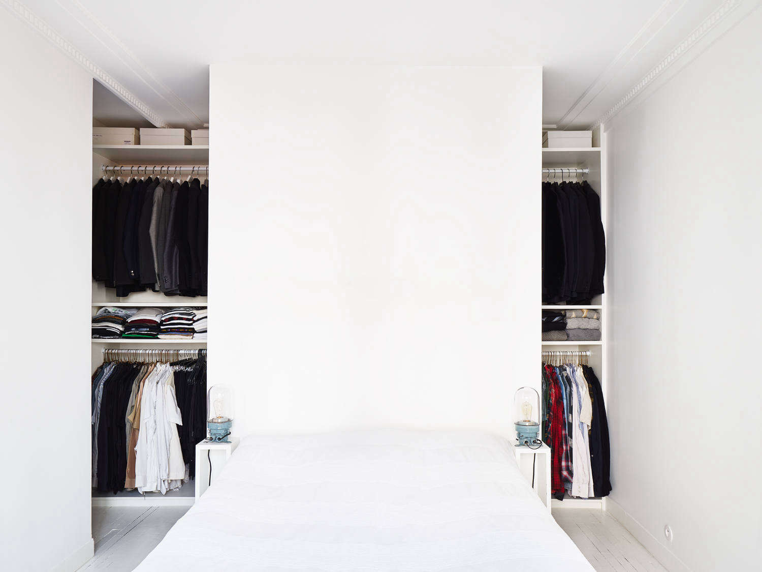 The architects of this 645-square-foot Paris apartment carved out closet space behind the bedroom to accommodate the large wardrobes of the homeowners, both of whom work in fashion. See more in Think Big: 9 Small-Space Layout Ideas to Steal from a Petite Paris Apartment. Photograph by David Foessel, courtesy of Septembre Architecture.