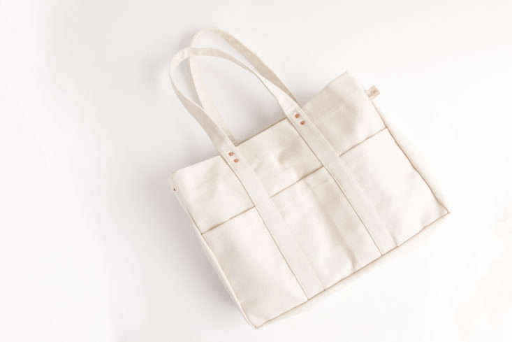 Floral Society makes one of our favorite wall organizers (see Margot's post on its products), and now, one of our favorite white bags. Its Canvas Utility Tote has seven pockets and a key ring to keep you organized; $138 at Of a Kind.
