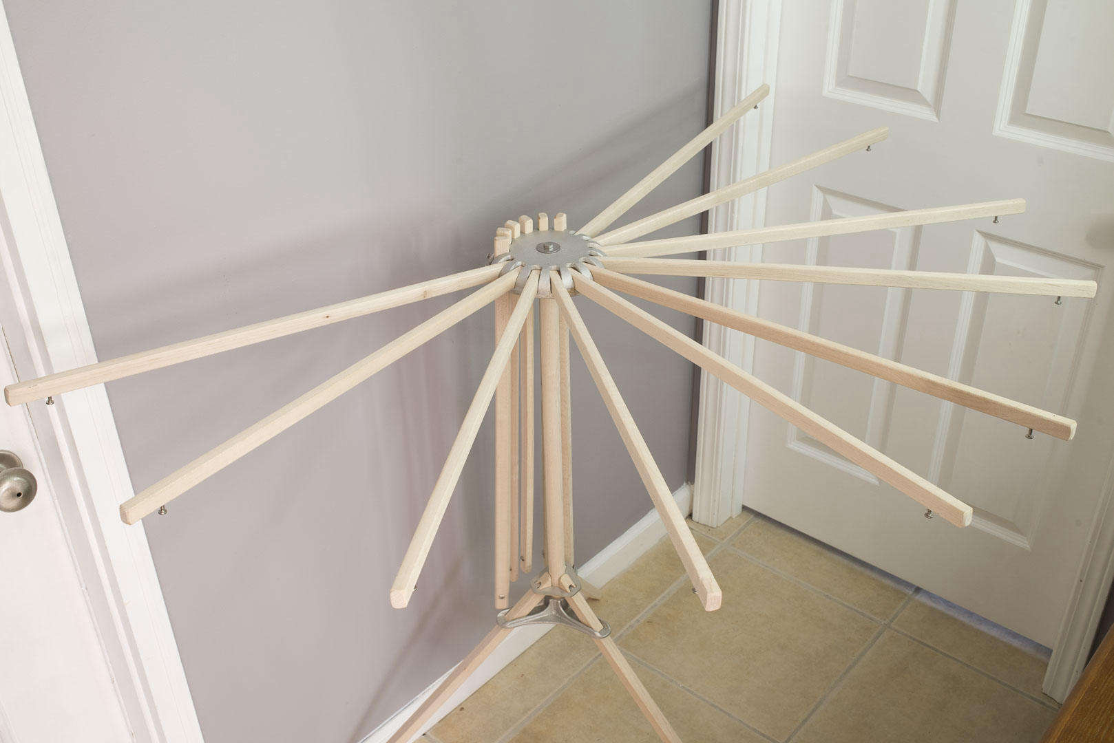"Above: The arrival of the Best Drying Rack has reaffirmed what I have always known: ""When things are simple and easy to use, people (teens included) actually use them."" Made in the US of maple hardwood dowels and corrosion-resistant steel, the Best Drying Rack features stable tripod construction; $79.00."
