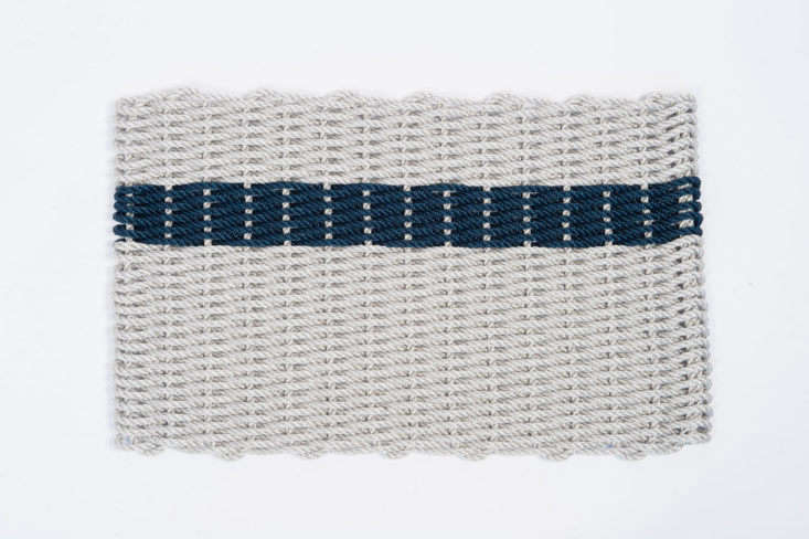 The Rope Co. website offers a range of colors and patterns for the Nautical Rope Doormat, including this Fog Gray and Navy Stripe version; $83.