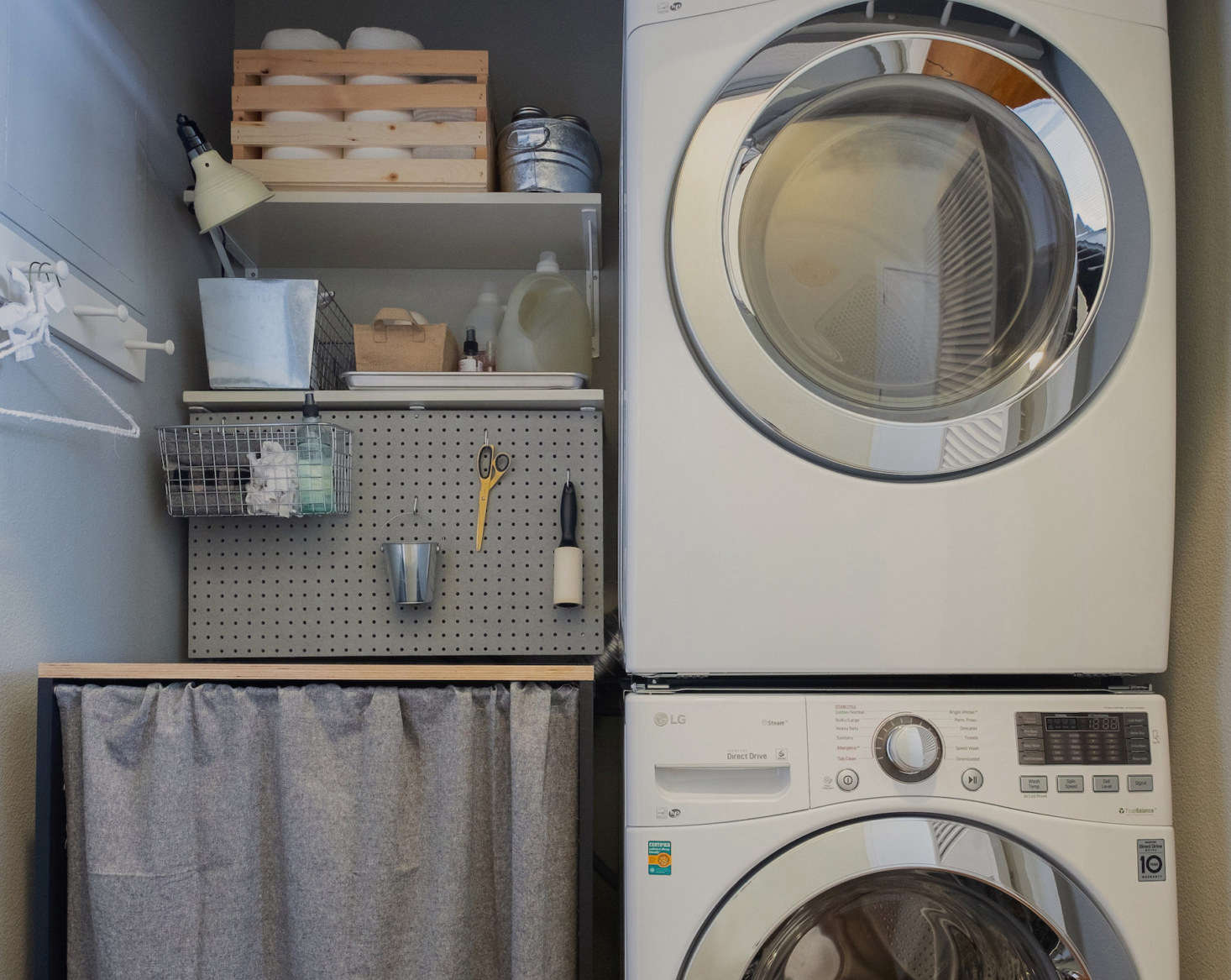 If you have a stacked washer and dryer, you may end up with room to spare in your laundry closet. Here, Meredith added a pegboard and open shelving for extra storage, a countertop for a laundry-folding surface, and a curtain around it to conceal a kitty litter underneath. See the details of her DIY project in Before & After: A Pet-Friendly Overhaul for the Laundry Closet. Photograph by Mahyar Abousaeedi for Remodelista.