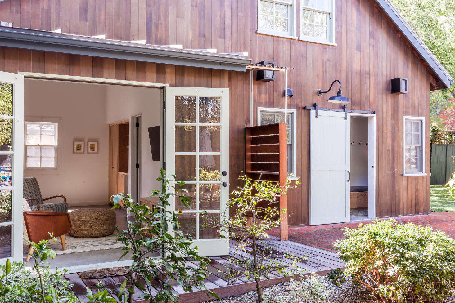 turn garage into office cost christine lennon guest barn outdoor shower image by stephen paul and anderson smallspace living garage conversion that prioritizes smart storage