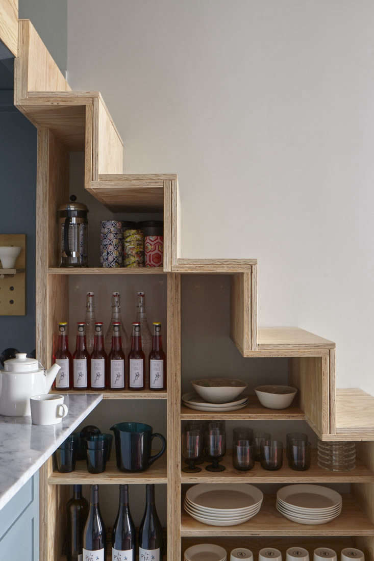 Staircase Shelving in Tiny Paris Apartment by Marianne Evennou