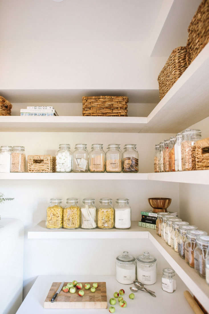 Open shelving means she can easily locate what she needs; her grains, pastas, and baking essentials are all stored in attractive airtight glass jars.